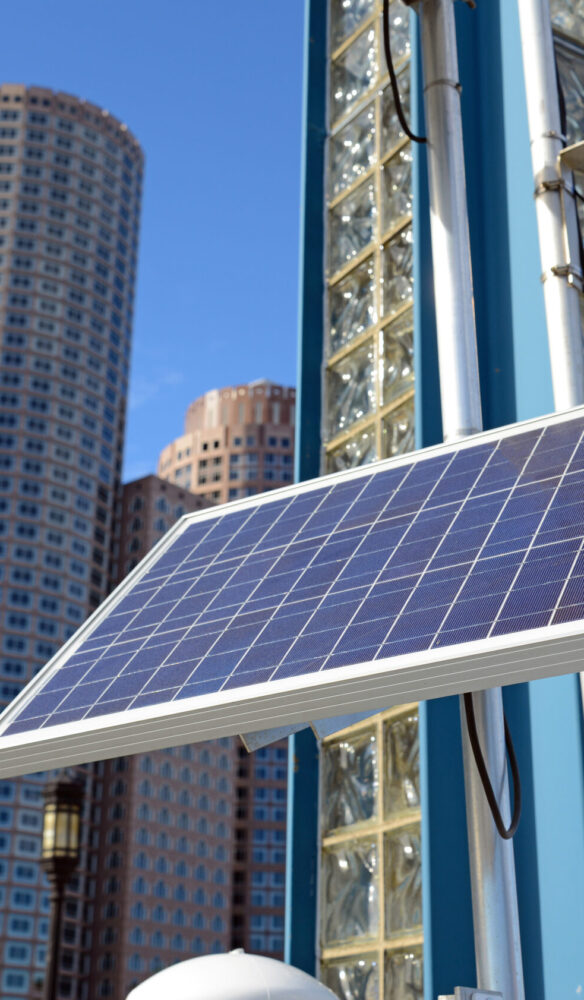 Solar,Panel,In,Urban,Environment,With,Buildings,And,Skyscrapers,In